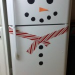 decorate your fridge to look like a snowman