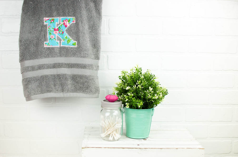 Color gray both towel with a beautiful letter K monogram on it