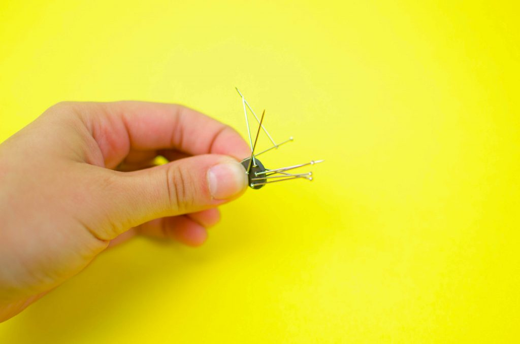 use a magnet to pick up loose pins in your sewing room