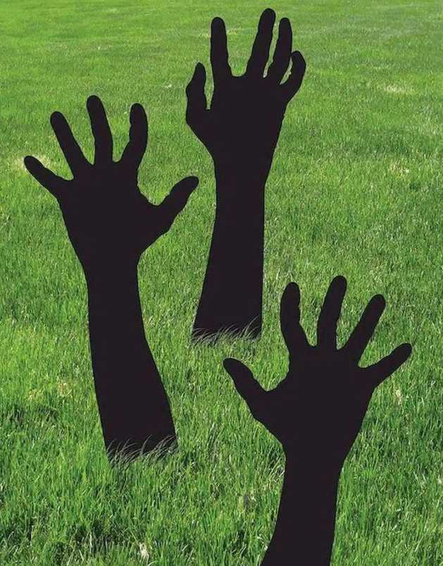 hands reaching up from the ground