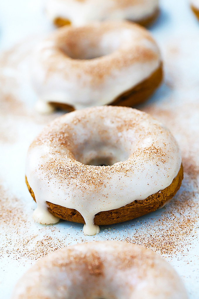 Baked pumpkin donuts with maple glaze and cinnamon-sugar