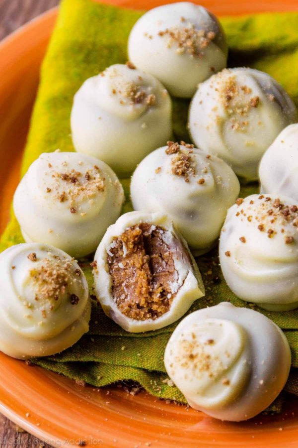 Pumpkin spice truffles coated with white chocolate and sprinkled with graham cracker crumbs