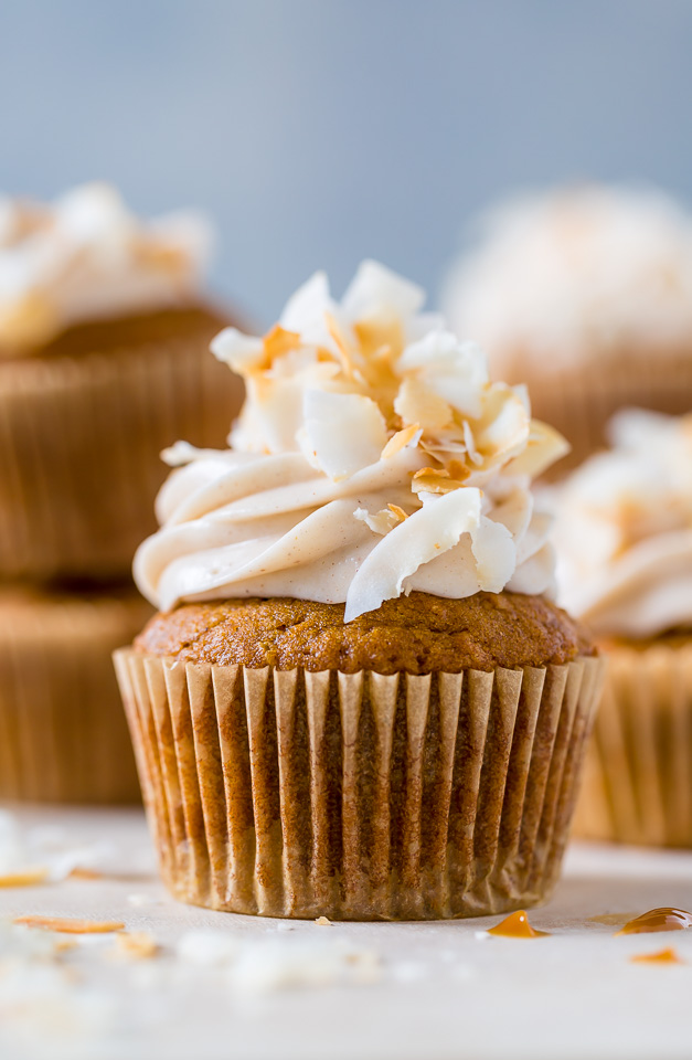Moist and fluffy Pumpkin Coconut Cupcakes stuffed with Dulce de Leche and covered in Cinnamon Cream Cheese frosting