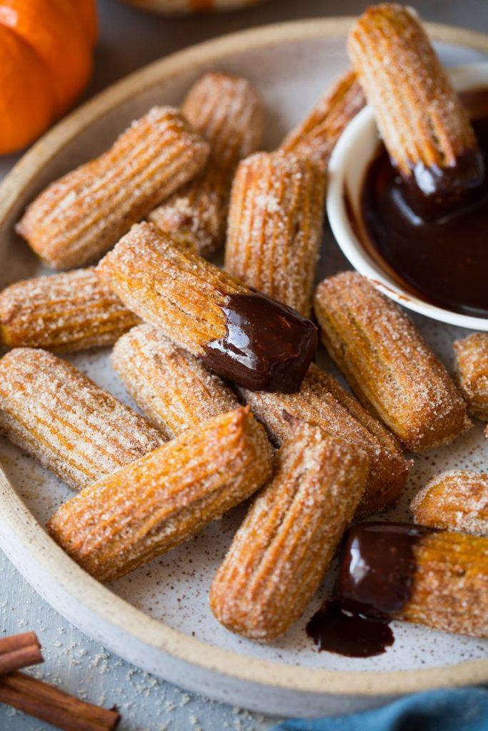 Baked pumpkin churros coated in cinnamon sugar with chocolate dip