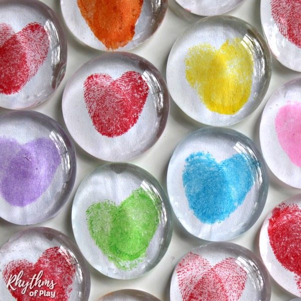 Colorful fingerprint art glass magnets an easy craft perfect for stocking stuffer