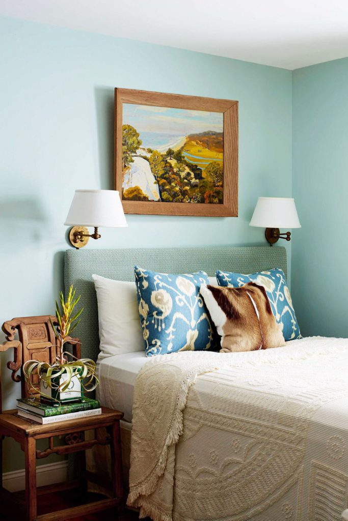 use wall sconces in place of lamps to save space