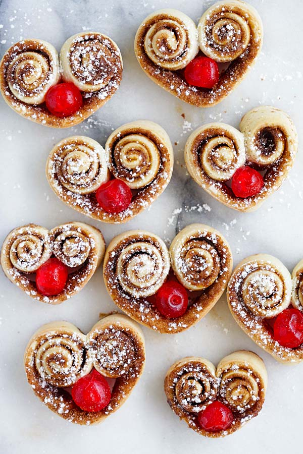 Cutest heart shaped cinnamon rolls stuffed with red cherries