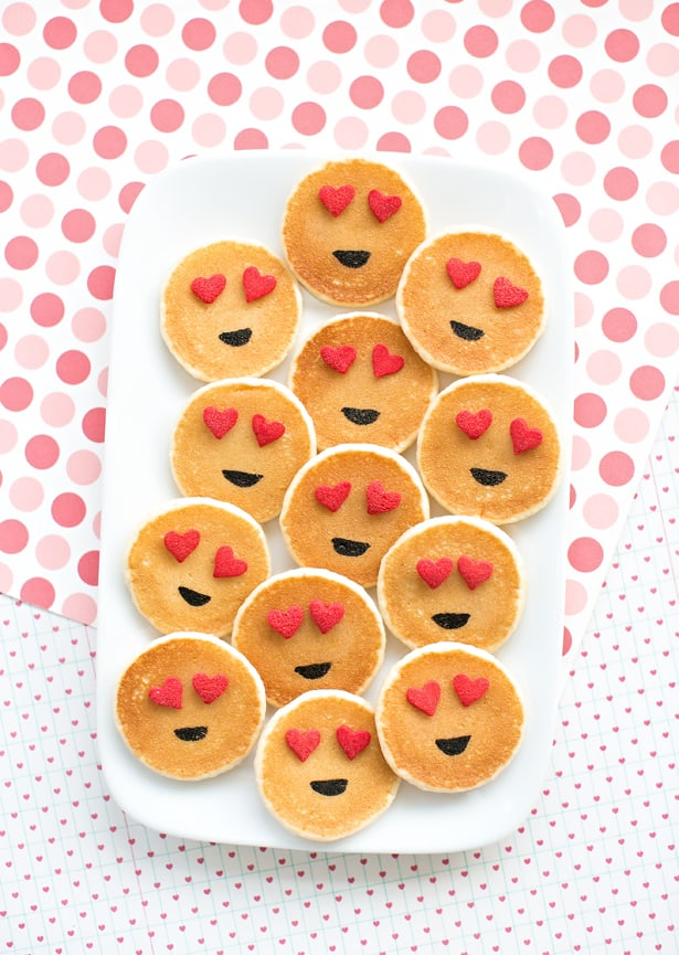 Mini pancakes with smiley and heart eyes emoji