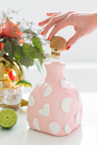diy air dry clay decanter formed around an empty bottle