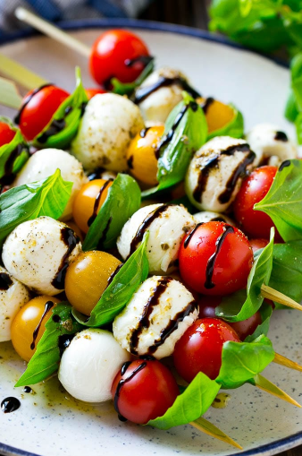 caprese skewers combine tomatoes with basil, mozzarella, olive oil and balsamic