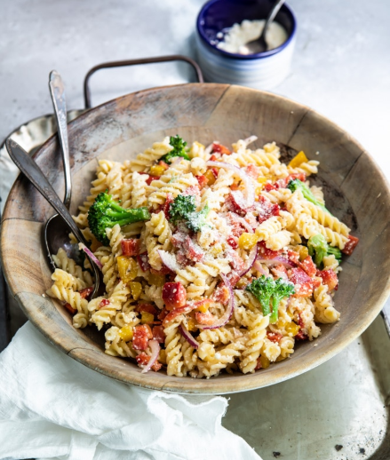 Simple, but scrumptious cold pasta salad that has broccoli, bell peppers, zesty Italian dressing and Parmesan cheese