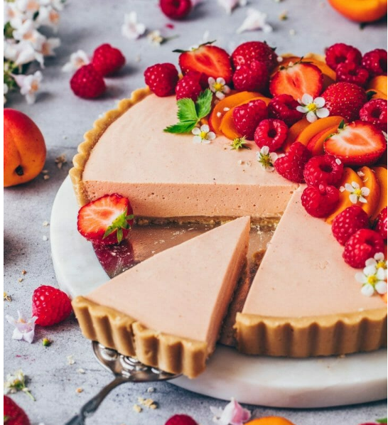 amazing no bake fresh summer fruit cream tart topped with strawberries, raspberries, mangoes, apricots and peaches