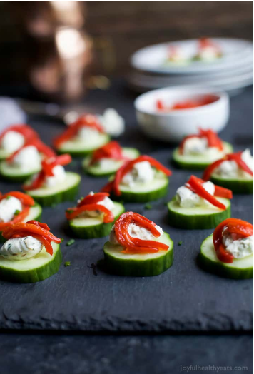 Fresh and simple cucumber bites topped with a zesty Herb Cream Cheese and sweet Piquillo Peppers
