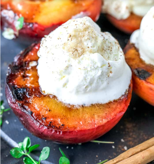 Brown sugar grilled peaches with a scoop of vanilla ice cream on top
