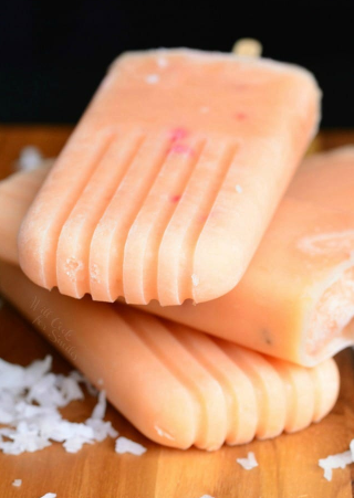 A summer delight creamy fruit ice pops made with coconut milk, honey, and peaches