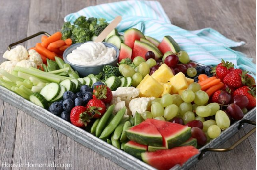 Charcuterie board with delicious and healthy fruits and vegetables perfect for parties