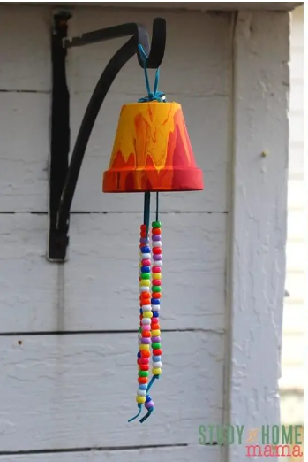 A garden wind chimes using a flower pot and has a string beads