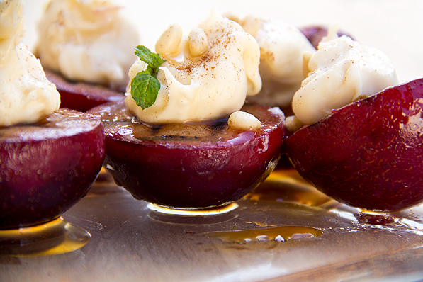 Grilled cinnamon plums with sweetened mascarpone, vanilla honey and toasted pine nuts