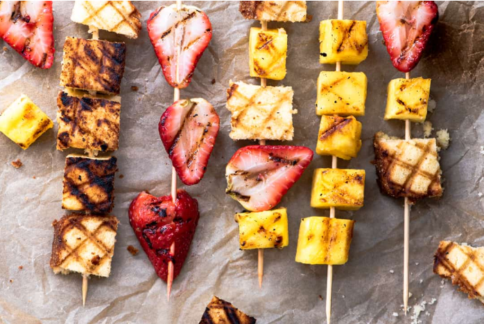 Grilled strawberries, bananas, and coconut pound cake skewers