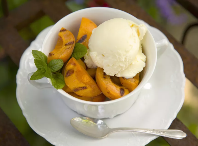 Grilled apricots and honey with a scoop of ice cream