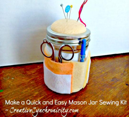 mason jar sewing kit with felt pincushion on top and felt pockets around the sides