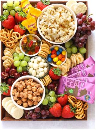 Popcorn movie snacks platter perfect for friends and family board treats