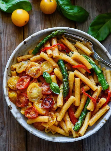 A delicious and easy to prepare pasta with asparagus, bell pepper, and tomato