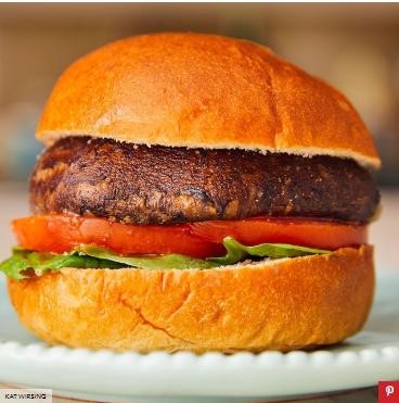 Portobello mushroom burger with sliced of tomato and lettuce