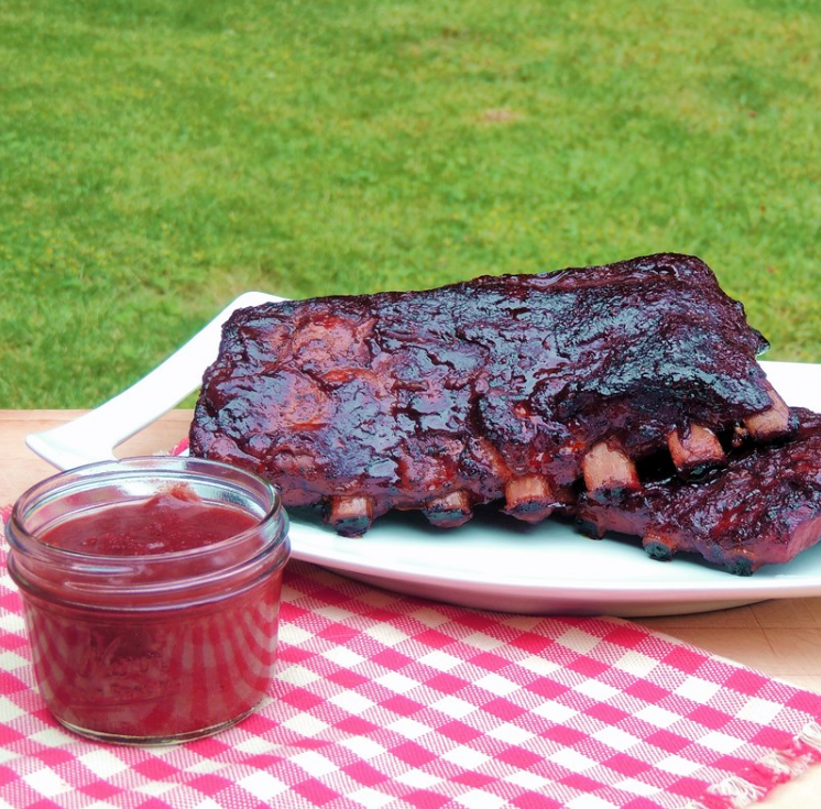 A mouth watering slab of BBQ ribs rub with a roasted strawberry BBQ sauce