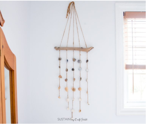 Simple seashell windchimes hang on the wall