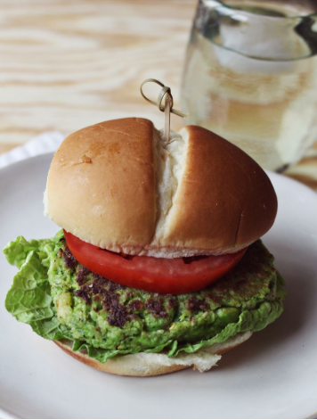 Spicy edamame burger with sliced of tomato
