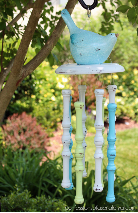 Spindle wind chimes with a bird as a top piece