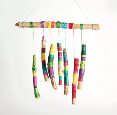Stick wind chimes decorated with various colors of acrylic paint onto sticks and embroidery floss