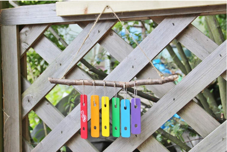 Xylophone wind chimes hang on a wall