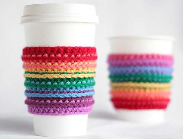 A crochet rainbow cup cozy