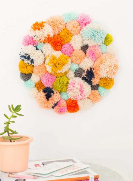 A beautiful yarn pompom wall hanging
