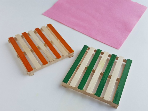 A very cute and useful homemade popsicle stick coasters