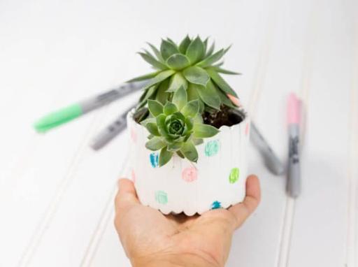 A homemade planter craft tutorial made of popsicle sticks for kids