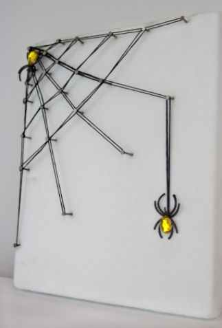 Simple spider web string art perfect for Halloween decoration