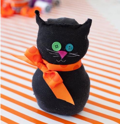 Spooky black sock cat