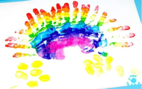 A handprint rainbow painting.