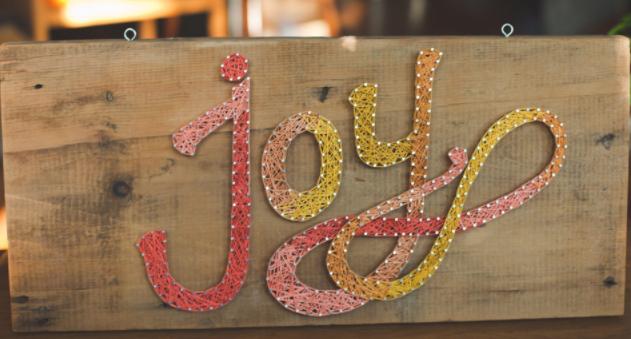 a beautiful joy string art sign