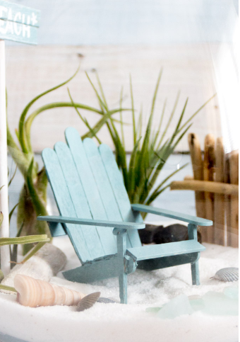 An adorable wooden mini adirondack chair crafts made of popsicle sticks