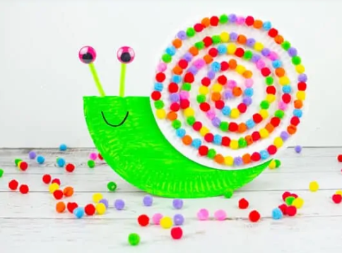 Adorable rocking snails with googly eyes and colorful pom pom spiral shell.