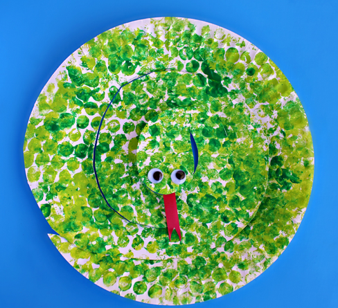 Paper plate cut into a spiral shape then painted using a bubble wrap to make it looks like a snake