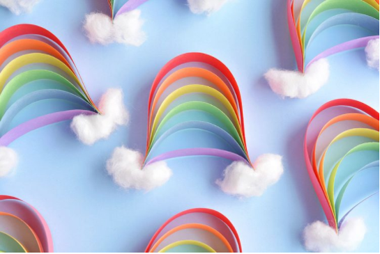 A rainbow using paper strips with clouds on it.