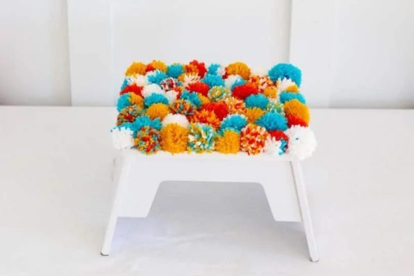 A Soft, Fluffy DIY Pom Pom Footstool
