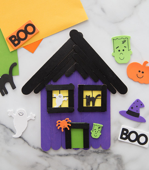 A popsicle stick haunted house craft for kids perfect for holloween