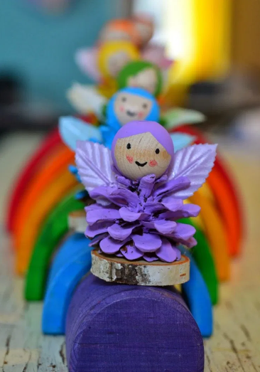 Rainbow fairies made from pinecones