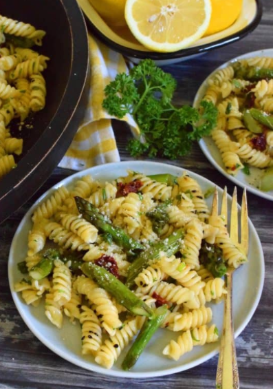 roasted asparagus lemon butter pasta salad tossed with sun dried tomatoes, fresh lemon, and parmesan